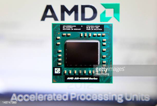 An Advanced Micro Devices Inc AMDA104600M Series APU computer chip is displayed at the AMD booth at the Computex Taipei 2011 in Taipei Taiwan on...