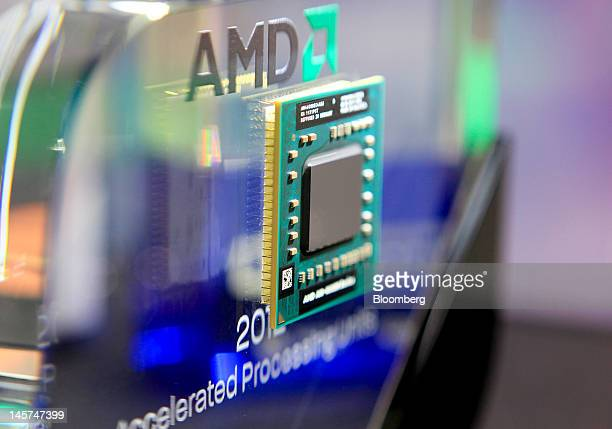 An Advanced Micro Devices Inc AMDA104600M Series APU computer chip is displayed at the AMD booth at Computex Taipei 2012 in Taipei Taiwan on Tuesday...