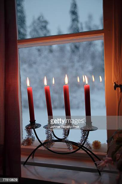 An Advent candlestick in a window.