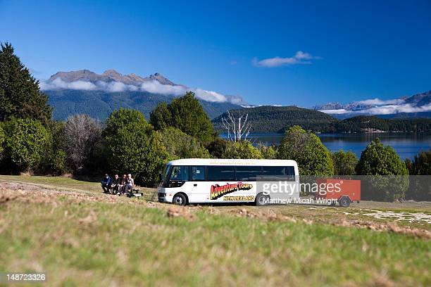 An Adventure Tours tour bus stops alongside the Manapouri Lake before boarding their ferry en route to Doubtful Sound