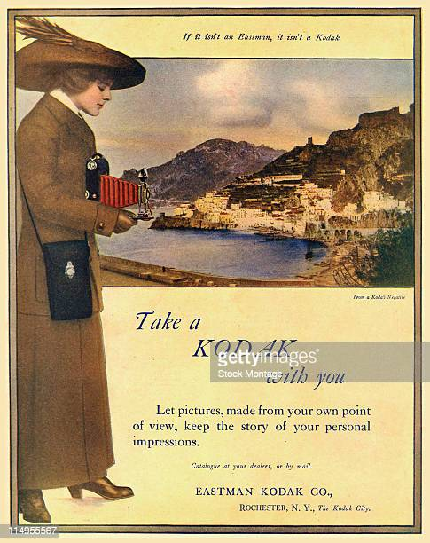 An advertisemen for Kodak folding cameras early 1910s The illustration features a woman aiming a camera and behind her a colorized photograph of a...