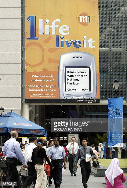 An advertisement billboard of Singapore's second largest mobile phone company MobileOne is displayed on a building wall in Singapore 15 April 2004...