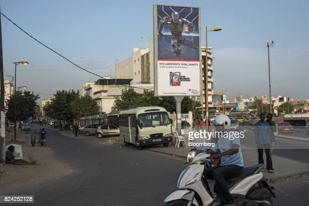 An advertisement board for Total SA oil stands in Dakar Senegal on Friday July 28 2017 Senegalese voters will elect a new parliament on Sunday in a...