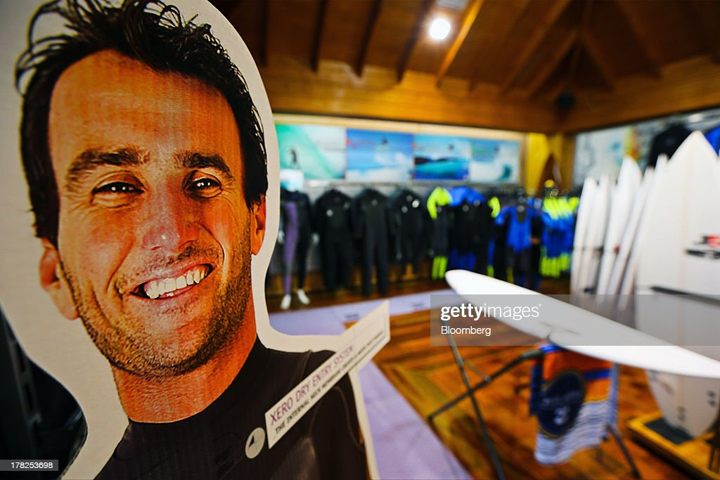 An advertisement, displaying Joel Parkinson the 2012 Association of Surfing Professionals (ASP) World Champion, stands inside a Billabong International Ltd. retail store at the company's headquarters in Burleigh Heads, Australia, on Wednesday, Aug. 28, 2013. Billabong, the surf brand founded in 1973, helped sell Australian surfing culture worldwide and rose to a market value of A$3.84 billion ($3.45 billion) at its peak in 2007 said its 40-year-old surf brand was worthless after the companys losses tripled amid store closures, firings and a breach of debt terms. Photographer: Patrick Hamilton/Bloomberg via Getty Images