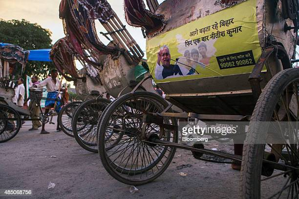 An advertisement featuring opposition coleader Nitish Kumar is displayed on the back of a rickshaw in Patna Bihar India on Monday July 27 2015 More...