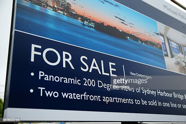 An advertisement for a residential property listed by Sotheby's International Realty stands on display in the suburb of Point Piper in Sydney...