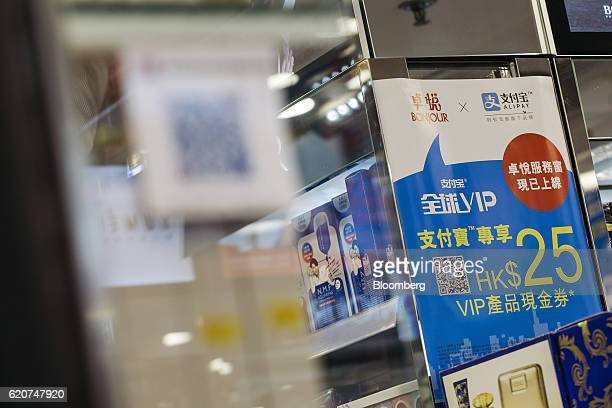An advertisement for Ant Financial Services Group's Alipay an affiliate of Alibaba Group Holding Ltd is displayed at a Bonjour Holdings Ltd store in...