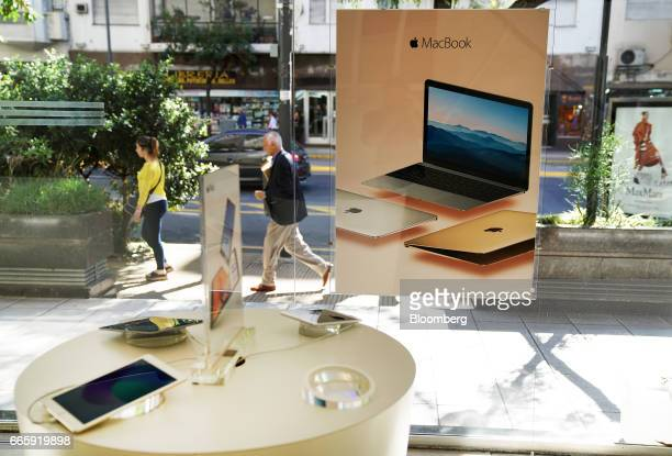 An advertisement for Apple Inc laptop computers is displayed at a Maxim Store in Buenos Aires Argentina on Friday April 7 2017 Apple Inc's iPhone...