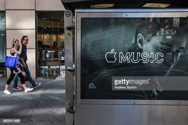 An advertisement for Apple Music is posted on the streets of Manhattan on August 7 2015 in New York City After launching in June Apple announced it...