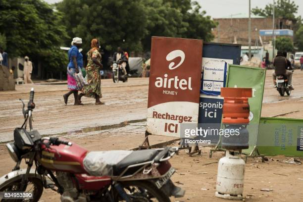 An advertisement for Bharti Airtel Ltd telecom services stands on a roadside in N'Djamena Chad on Tuesday Aug 15 2017 African Development Bank and...