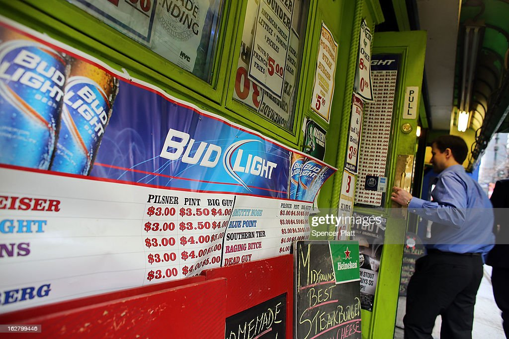 An advertisement for Budweiser beer is displayed outside of a bar on February 27, 2013 in New York City. In a new class action lawsuit against Anheuser-Busch, beer enthusiasts have accused the company of watering down its Budweiser, Michelob and other beers. The suits, which were filed in Pennsylvania, California and other states, are seeking millions in damages for allegedly cheating customers out of the alcohol content stated on labels. Anheuser-Busch calls the suit groundless.