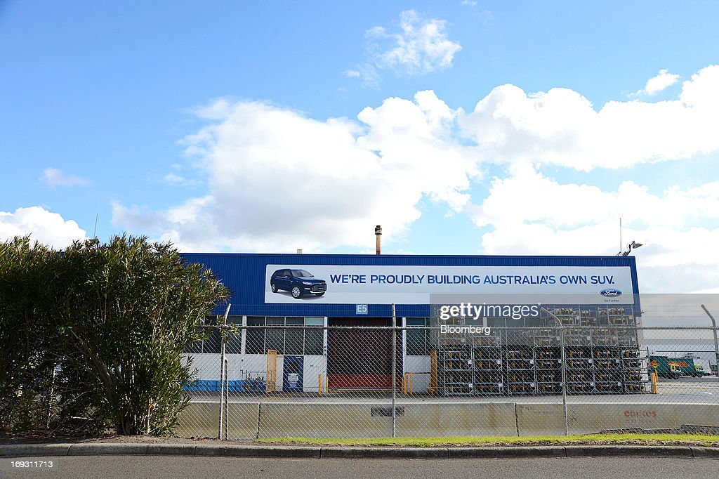 An advertisement for Ford Motor Co.'s Territory sport-utility vehicle (SUV) is displayed outside the company's Broadmeadows assembly plant in Melbourne, Australia, on Thursday, May 23, 2013. Ford will stop making cars in Australia, nine decades after founder Henry Ford first began building Model Ts in the country, as a surge in the currency undermines the local industry's ability to compete with imports. Photographer: Carla Gottgens/Bloomberg via Getty Images