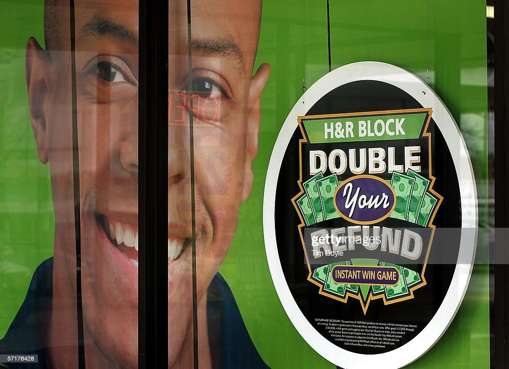 An advertisement for H&R Block's 'Double Your Refund' instant win game is seen in a window of an H&R Block facility March 24, 2006 in Des Plaines, Illinois. Americans are preparing for the income tax filing deadline next month while using tax software, filing on the paper forms or using a tax preparer.