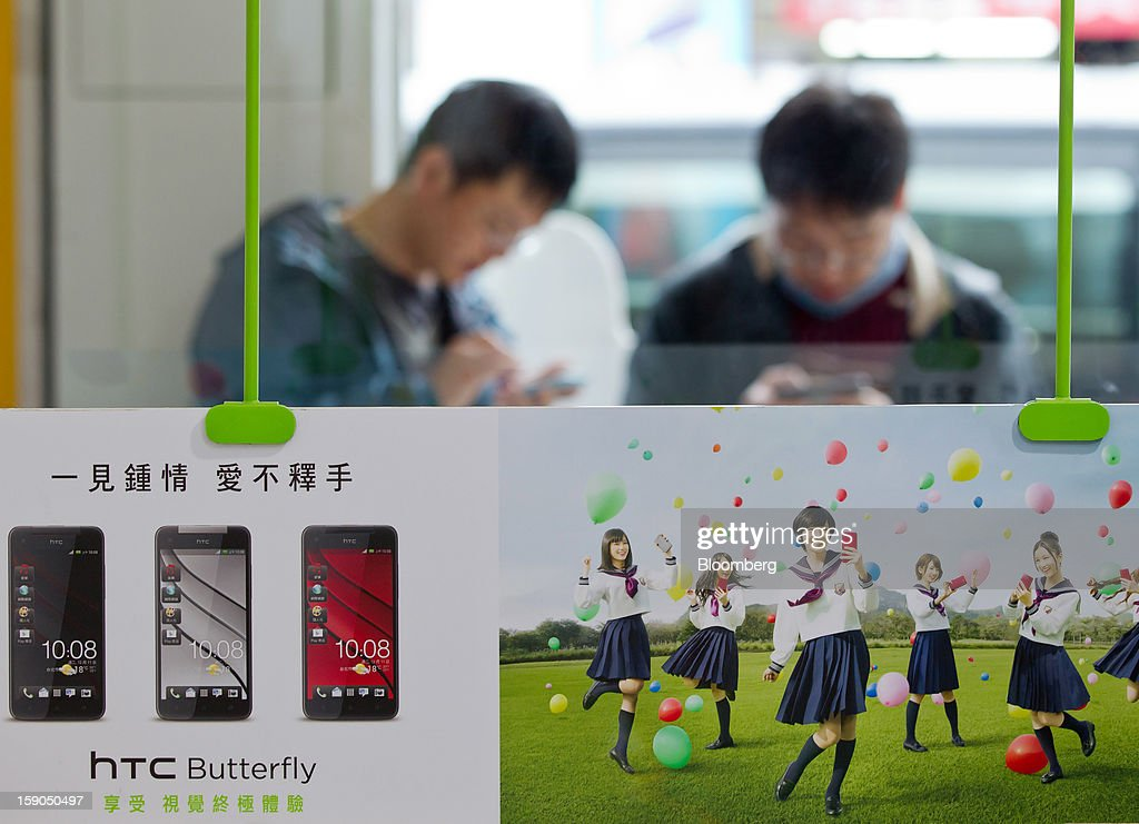 An advertisement for HTC Corp.'s Butterfly smartphone is displayed at one of the company's stores in Taipei, Taiwan, on Sunday, Jan. 6, 2013. HTC is scheduled to release fourth-quarter earnings on Jan. 7. Photographer: Maurice Tsai/Bloomberg via Getty Images
