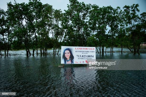 An advertisement for land is seen in floodwaters during the aftermath of Hurricane Harvey August 27 2017 in Pearland Texas Hurricane Harvey left a...
