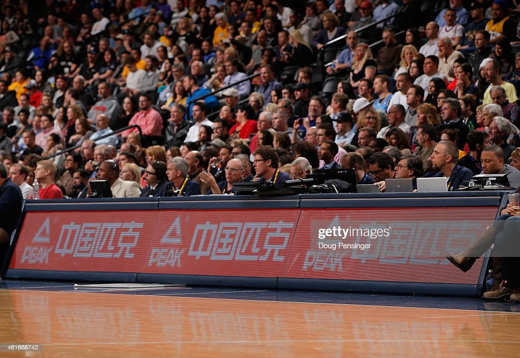 An advertisement for Peak Chinese basketball shoes is displayed on the sidelines as the San Antonio Spurs face the Denver Nuggets at Pepsi Center on...