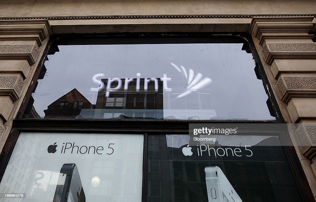An advertisement for the Apple Inc. iPhone 5 is displayed in the window of a Sprint Nextel Corp. store in New York, U.S., on Monday, April 15, 2013. Dish Network Corp., the satellite-TV company controlled by Charlie Ergen, made an unsolicited $25.5 billion offer for Sprint Nextel Corp., topping a Softbank Corp. bid for the third-largest U.S. wireless carrier. Photographer: Victor J. Blue/Bloomberg via Getty Images