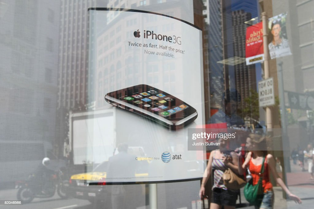 An advertisement for the Apple iPhone is displayed in the window of an AT&T Wireless store July 23, 2008 in San Francisco, California. AT&T reported a 30 percent increase in second quarter earnings today citing storing sales of the Apple iPhone. The company earned $3.77 billion, or 63 cents per share compared to $2.90 billion, or 47 cents per share, one year ago.