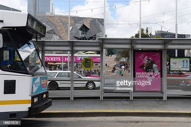 An advertisement for the Melbourne Cup thoroughbred horse race adorns a tram stop outside Flinders Street train station in Melbourne Australia on...