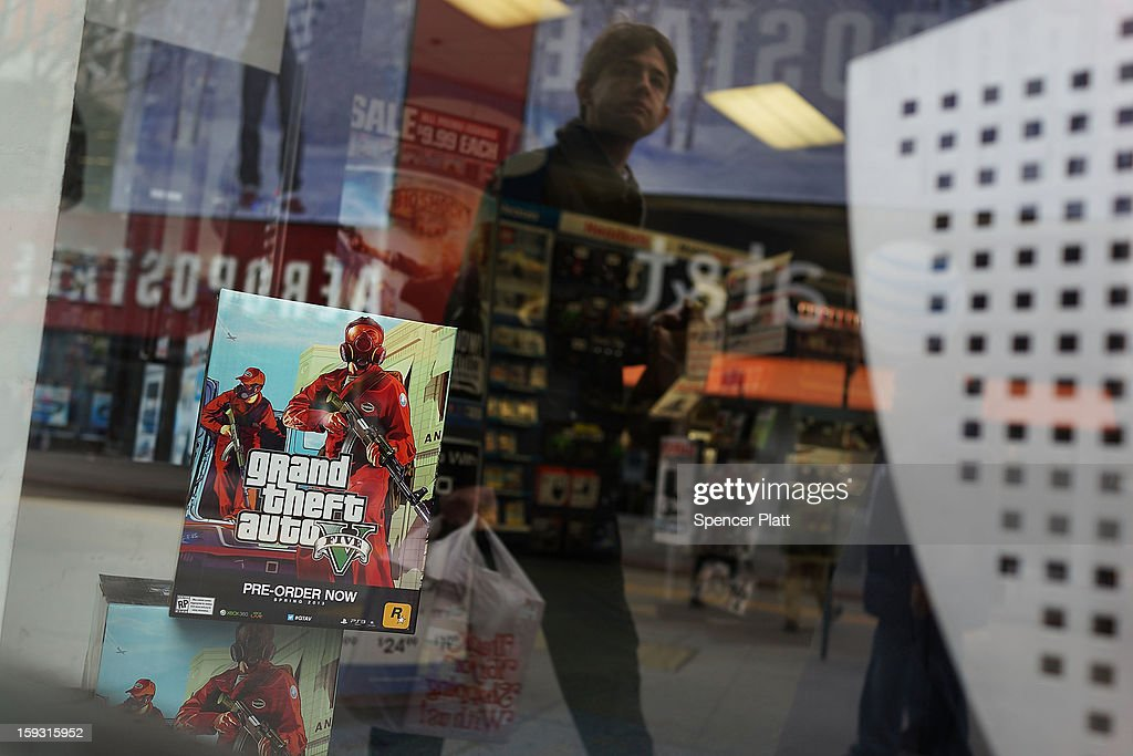 An advertisement for the new Grand Theft Auto is viewed at a Brooklyn gaming store on January 11, 2013 in New York City. Following the shootings of children at a elementary school last month in Connecticut, numerous politicians and activists have begun to focus on violence in video games and films. US vice-president Joe Biden is meeting with games industry representatives today to discuss graphic violence, often with guns, in many of today's most popular video games. The administration is also expected to address violence in the film industry as well.