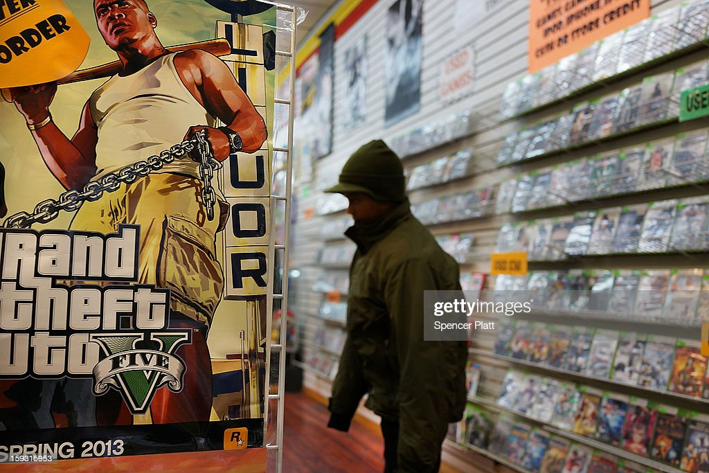 An advertisement for the new Grand Theft Auto is viewed at a gaming store on January 11, 2013 in New York City. Following the shootings of children at a elementary school last month in Connecticut, numerous politicians and activists have begun to focus on violence in video games and films. US vice-president Joe Biden is meeting with games industry representatives today to discuss graphic violence, often with guns, in many of today's most popular video games. The administration is also expected to address violence in the film industry as well.