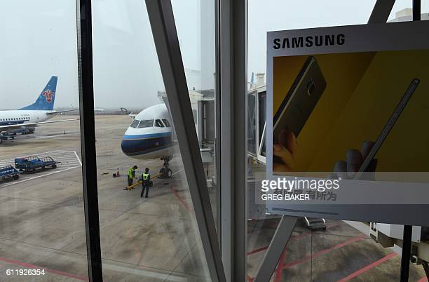 An advertisement for the Samsung Galaxy Note 7 smartphone is seen on an air bridge leading to a plane at the airport in Wuhan in China's central...