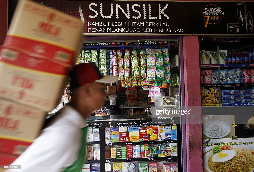 An advertisement for Unilever NV's Sunsilk line of hair care products is displayed above a store in Jakarta, Indonesia, on Wednesday, Nov. 14, 2012. Unilever has accelerated the rollout of shampoos and deodorants to emerging markets such as Indonesia and China to offset slowing growth in developed markets, where higher price tags have deterred consumers. Photographer: Dadang Tri/Bloomberg via Getty Images