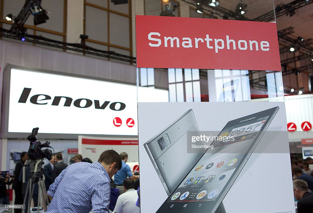 An advertisement hoarding for a K900 Smartphone, manufactured by the Lenovo Group Ltd, stands on display on the eve of the opening of the IFA consumer electronics show in Berlin, Germany, on Thursday, Sept. 5, 2013. Samsung showed the Galaxy Gear yesterday at IFA, Europe's largest consumer-electronics show, as it races Apple and Sony Corp. to carve a share of the market for wearable technology amid slowing growth in smartphones. Photographer: Krisztian Bocsi/Bloomberg via Getty Images