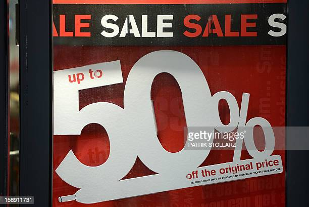 An advertisement offers 50 percent off in a window of a shopping center on January 3 2013 in Essen western Germany Official start of the winter sale...