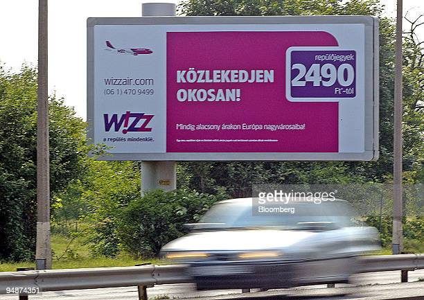 An advertisement touting lowcost carrier Wizz Air's cheap fares 'starting at 9 euros oneway' is seen near Ferihegy International Airport in Budapest...