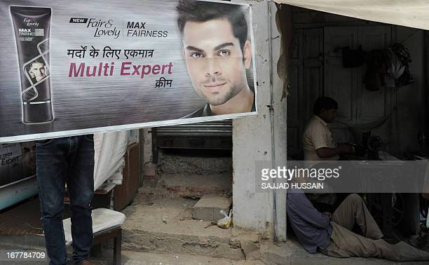 An advertising banner for Unilever product Fair and Lovely skin fairness cream is displayed outside a shop in New Delhi on April 30 2013 Food giant...