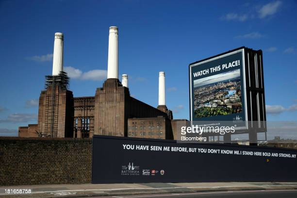 An advertising billboard shows residential development information outside Battersea power station in London UK on Friday Sept 20 2013 Malaysian...