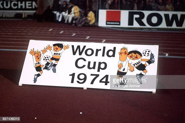 An advertising board for the 1974 World Cup Finals featuring the official mascots Tip and Tap