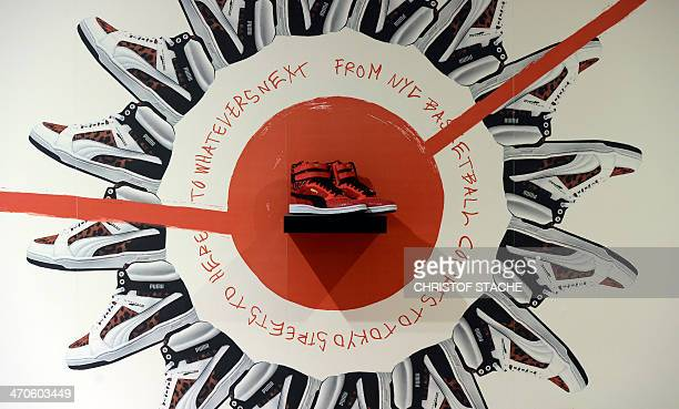 An advertising for shoes of German sportswear maker Puma is on display during the company's annual press conference on February 20 2014 in...