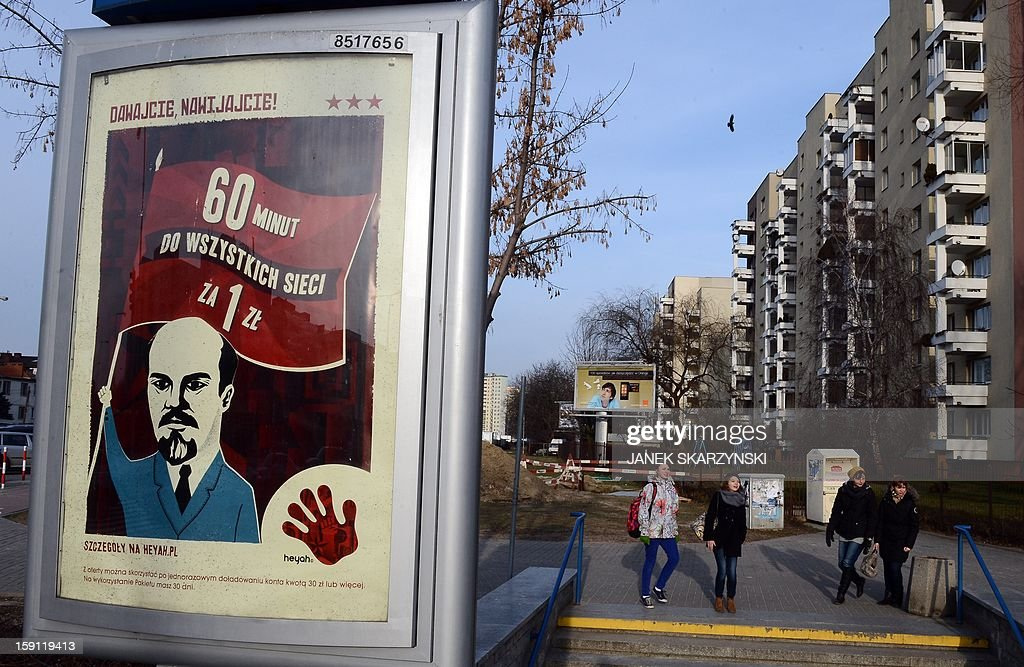 An advertising poster by one of Polish mobile operators featuring a caricature of former Soviet leader Vladimir Lenin is pictured in Warsaw on January 8, 2013. Public protests agaist it, have forced the operator to pull out the poster from bilboards.