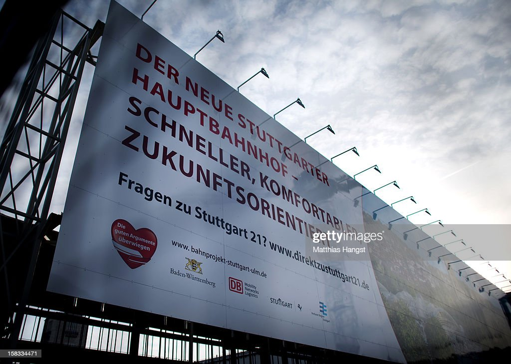 An advertising poster for Stuttgart 21 is seen near the construction site of the Stuttgart 21 railway station on December 13, 2012 in Stuttgart, Germany. German state rail carrier Deutsche Bahn, which is carrying out the massive project, announced yesterday that final costs will be EUR 1.1 billion more than previously expected, bringing the total cost to EUR 5.6 billion. The project will replace the current overground, terminal station with a more efficient underground one. Critics have decried the project as too expensive and too environmentally risky.