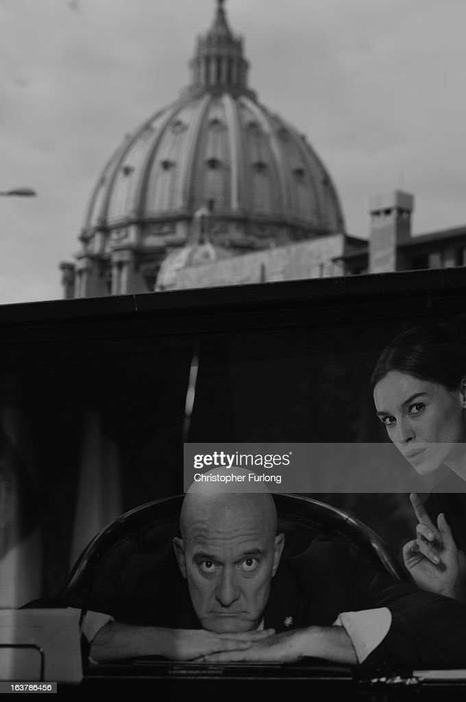 . An advertising poster sits in front of St Peter's Basilica on March 15, 2013 in Rome, Italy. Daily life continues around the vatican as romans prepare for the inauguration mass of Pope Francis, the first ever Latin American Pontiff.