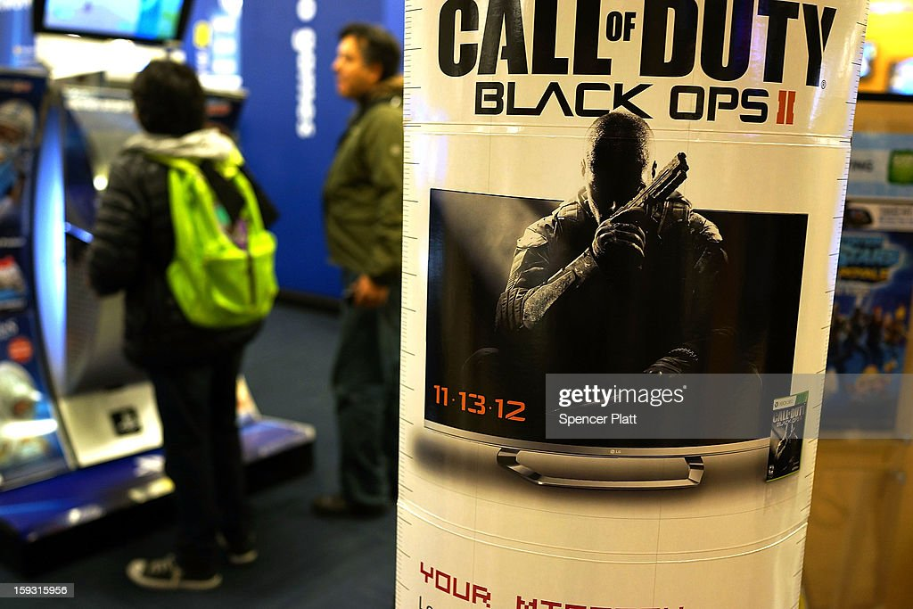 An advertisment for the game Call of Duty Black Ops 2 is viewed at an electronics store on January 11, 2013 in New York City. Following the shootings of children at a elementary school last month in Connecticut, numerous politicians and activists have begun to focus on violence in video games and films. US vice-president Joe Biden is meeting with games industry representatives today to discuss graphic violence, often with guns, in many of today's most popular video games. The administration is also expected to address violence in the film industry as well.