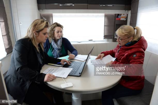 An advisor of roaming public services helps inhabitants to carry out their administrative procedures on April 27 2017 inside a camping car parked in...