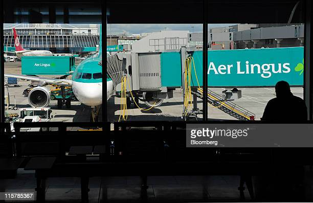 An Aer Lingus Group Plc aircraft sits on the tarmac at Dublin Airport in Dublin Ireland on Thursday June 9 2011 Aer Lingus Group Plc's total booked...