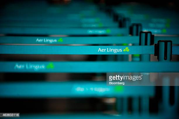 An Aer Lingus logo sits on queue dividers at the empty Aer Lingus Group Plc checkin desk in the departure hall at Dublin Airport operated by Dublin...