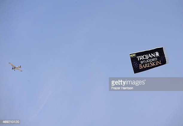 An aerial advertising plane displays a banner for Trojan condoms during day 1 of the 2015 Coachella Valley Music Arts Festival at the Empire Polo...