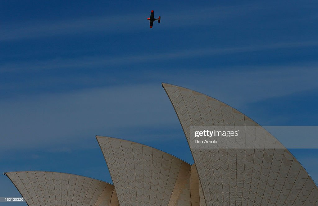 An aerial display is seen above Sydney Opera House just prior to Prince Harry's appearance at Campbell Cove on October 5, 2013 in Sydney, Australia. Over 50 ships participate in the International Fleet Review at Sydney Harbour to commemorate the 100 year anniversary of the Royal Australian Navy's fleet arriving into Sydney. Prince Harry is an official guest of the Australian Government and will take part in the fleet review during his two-day visit to Australia.
