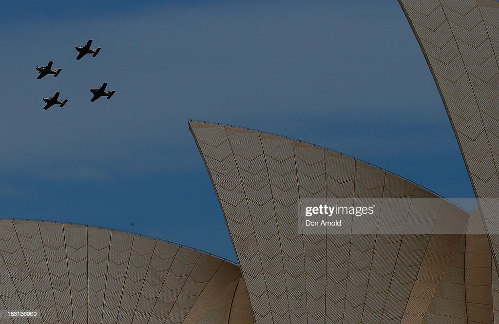 An aerial display is seen above Sydney Opera House on October 5, 2013 in Sydney, Australia. Over 50 ships participate in the International Fleet Review at Sydney Harbour to commemorate the 100 year anniversary of the Royal Australian Navy's fleet arriving into Sydney. Prince Harry is an official guest of the Australian Government and will take part in the fleet review during his two-day visit to Australia.