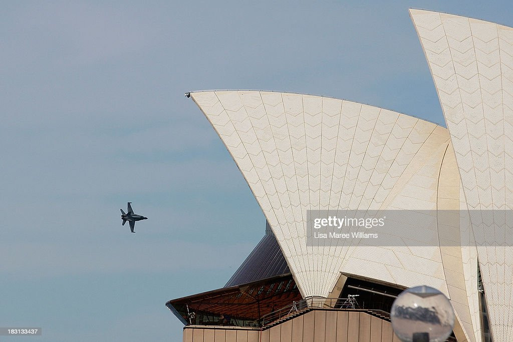An aerial display is seen above the Opera House prior to the arrival of Prince Harry at Campbell Cove on October 5, 2013 in Sydney, Australia. Over 50 ships participate in the International Fleet Review at Sydney Harbour to commemorate the 100 year anniversary of the Royal Australian Navy's fleet arriving into Sydney. Prince Harry is an official guest of the Australian Government and will take part in the fleet review during his two-day visit to Australia.