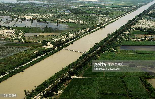 An aerial image shows water covering large stretches of land in Pakistan's southern province of Punjab on August 18 2010 Foreign aid began flowing in...