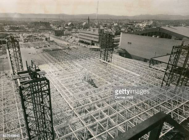 An aerial over all view of the white space frame and the black lifting towers as seen from the 810 14th StBuilding that houses some of the municipal...