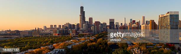 An aerial panoramic view of the city of Chicago at sunset