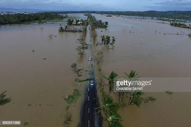 TOPSHOT An aerial photo shows a flooded highway after typhoon NockTen made landfall in Polangui Albay province on December 26 2016 Typhoon NockTen...