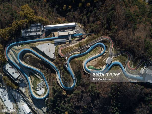 TOPSHOT An aerial photo shows a general view of the bobsleigh and luge venues of the Pyeongchang 2018 Winter Olympic games in Pyeongchang on October...